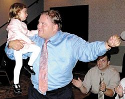 "The late Elias ""Louie"" Sarris is shown dancing with his niece, Zoe Marika, of Chicago, at a baptism in Dubuque."
